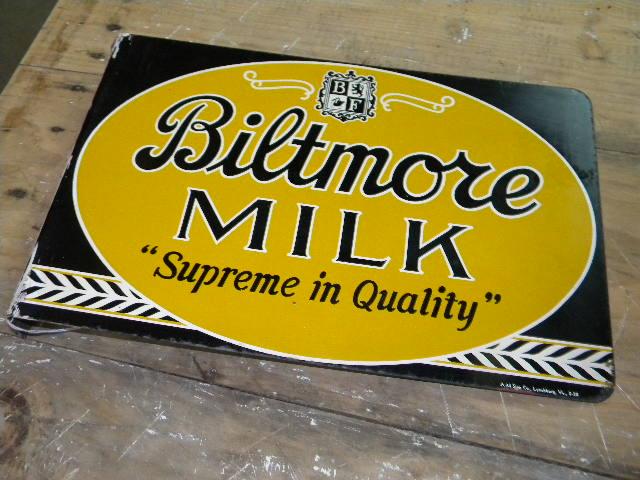 photo old biltmore dairy tin flange sign